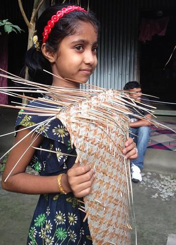 Eleven year old artist designing Sitalpati mats...