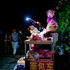 Wechat First (imvern) Tags: china road street light man fruit night 35mm canon eos stand phone mark f14 candid sigma ii chinadigitaltimes 5d dg nanning guangxi hsm dancun wechat