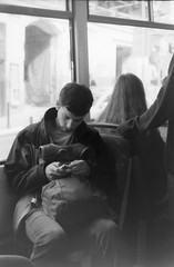 Kiev 4 - Tired Young Man in the Bus 2 (Kojotisko) Tags: street people film vintage streetphotography retro brno cc creativecommons czechrepublic streetphoto kiev kiev4