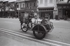 You Think You Have it Hard (OzGFK) Tags: street blackandwhite man film analog singapore asia chinatown nikkor nikonfm3a