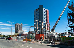 Busy Working (Jocey K) Tags: road street trees newzealand christchurch sky building cars architecture clouds fence theatre isaac royal cranes skips rebuild earthquakedamage
