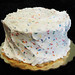 Simple Party - Two layers of white cake, filled and hand iced with our party sprinkled buttercream.