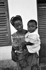Togo West Africa Beautiful Togolese African Mother and Daughter Village close to Palimé formerly known as Kpalimé is a city in Plateaux Region Togo near the Ghanaian border B&W May 5 1999 078 (photographer695) Tags: palimé togo west africa beautiful togolese african mother daughter village close formerly known kpalimé is city plateaux region near ghanaian border bw may 5 1999