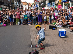 The young volunteer (Reinardina) Tags: boy summer england fun streetphotography falling entertainment laughter volunteer youngster act streettheatre familydayout freeevent hatfair2015 winchester2015 ernestdemagnifico