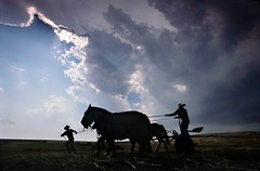 Getting the horses in as Sandhills Storm Approaches, Nebraska (JC Richardson) Tags: sunset horses cowboys clouds danger evening nikon nebraska farming thunderstorm rays posture prairie hurry drama nationalgeographic ranching sandhills greatplains dramaticlight jimrichardson