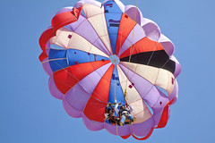 Patched up para Gliders (arfabita) Tags: ocean lighting travel pink blue red sea orange sun india color colour beach sports horizontal danger landscape fun coast seaside shadows ride purple beware horizon goa vivid bluesky landing negativespace coastal tropical parasail destination copyspace paraglider tones tropics radiant hazard clearsky generic paragliders parachute joyride comingin emptyspace clearbluesky horizonline liac holidayresort uttorda backtobase
