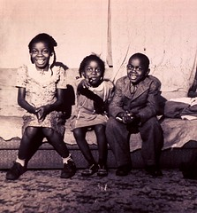 a029535 Black Children 1940 (Children's Bureau Centennial) Tags: girls boy black children sitting negro couch 1940s indianapolisindiana historyofmedicine nationallibraryofmedicine africanamericanchildren childrensbureau flannerhouse