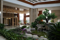 Little Garden Oasis in the Spacious & Elegant lobby of the Crowne Plaza Shanghai Anting (Crowne Plaza Hotels & Resorts) Tags: china plaza trees plants white green water fountain relax lights asia shanghai interior entrance lobby oasis enjoy service crown hotels spacious satisfaction elegant atrium interiordesign revolvingdoor checkin crowne crowneplaza ihg frontoffice fomula1 naturallights shanghaiinternationalcircuit f1shanghai hotelsresorts glassrooftop hotelinchina 5hotel formulaoneshanghai hotelsinshanghai intercontinentalhotelgroup crowneplazashanghaiantinggolf hotelinjiading hotelinantingjiading 5hotels hotelsinjiading hotelsinanting 5hotelsinshanghai luxuryhotelsinshanghai hotelsnearbyshanghaif1 f1shanghaihotels formula1shangha 6555boyuanroad 5hotelinanting besthotelinanting antinghotel formula1shanghaihotels crowneplazaantinggolf