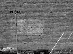 Brickwork (joeldinda) Tags: bw wall michigan patterns streetsign bricks brickwork grandledge joeldinda c50