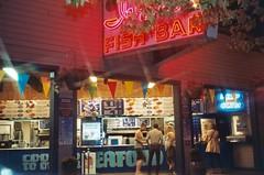 Ivars Waterfront Fish Bar (Anne Abscission) Tags: seattle 35mm washington lomo downtown neon glow waterfront 200asa ivars seafood expired smenasymbol pier54 oldsigns agfavista crossscreen fishbar steelsigns lomowalk