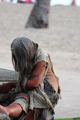 woman_on_beach_bench_Honolulu, Hawaii (Laura@PlantAndFlowerInfo.com) Tags: woman beach hawaii rags desolate tornclothing