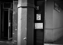 """meatheads"" (Robert S. Photography) Tags: street nyc bw art monochrome brooklyn graffiti sticker samsung 55mm meatheads st150f"