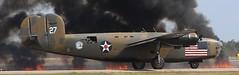 B-24 Diamond Lil & Fire (Bill Jacomet) Tags: show field fire airport wings texas air over houston diamond planes lil liberator b24 ellington 2013