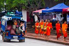 tuk-tuk and monks (jaypchances) Tags: orange asia religion monk buddhism parade line monks tuktuk procession laos tuk luangprabang