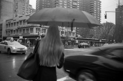 (RWhitesell) Tags: nyc blackandwhite film rain manhattan streetphotography konica delta100 umbrellas expiredfilm hexaraf