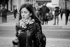 Alone In Her Thoughts (Leanne Boulton) Tags: life street city uk portrait pierced people urban blackandwhite bw woman white black girl monochrome beautiful beauty face field leather modern female composition canon hair nose mono scotland living town blackwhite aperture long pretty mood crossing emotion bokeh pavement expression glasgow candid centre young thoughtful style atmosphere pedestrian center scene piercing sidewalk human jacket portraiture thinking subject isolation brunette bandw depth facial stylish vision:people=099 vision:face=099 vision:outdoor=0831 vision:sky=068
