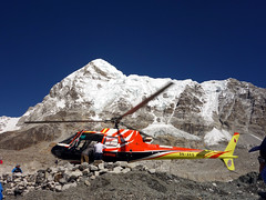 Helicopter arrives at Everest Base Camp (markhorrell) Tags: nepal trekking mountaineering everest everestbasecamp