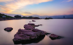 Serene Sunset at Rawal Lake (hamzaqayyum) Tags: sunset rocks serene reflection travel islamabad pakistan beauty longexposure