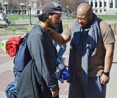 These two men pray together at a free clothing giveaway organized by the Inspire Church and the Refuge Church in Denver. (desrowVISUALS.com) Tags: poverty poorpeople religion austerity prayer praying faith hardtimes charity needy service freeclothing clothinggivaway theinspirechurch therefugechurch