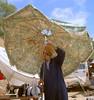 Thirst (ingelarene) Tags: thirst törst parasoll marocko man symaskin flaska ingelarené