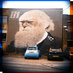 Darwin (bichrome image taken with black and white film) (pho-Tony) Tags: street blue red two blackandwhite bw white 3 black color colour green art film home st 35mm vintage square binocular lens beard graffiti three diy 3d mural graphic pair sheffield sydney victorian charles darwin evolution charlesdarwin stereo negative filter developer 01 f lee 400 processing rocket pan analogue filters ilford sergey combination separation stereographic wray trichrome ilfosol originofspecies rocket01 trichromie panf400 prokudingorsky wraystereographic faunagraphic sergeyprokudingorsky wraystereo