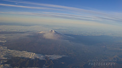 Aerial view of Mt. Etna (Andrea Rapisarda) Tags: winter sky snow clouds volcano nikon nuvole pano ngc aerialview cielo ash sicily 20mm etna eruption sicilia vulcano mtetna panoramicview eruzione ©allrightsreserved valledelbove nationalgeographicgroup crateredisudest d7000