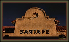 Now Departing (the Gallopping Geezer '5.0' million + views....) Tags: railroad travel newmexico santafe building station sign canon letters tracks structure historic adobe trainstation transportation depot passenger 2009 geezer corel