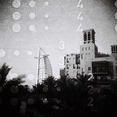 Burj 342 (sonofwalrus) Tags: دبي الإماراتالعربيةالمتحدة holga film lomo lomography scan uae unitedarabemirates dubai blackandwhite bw madinatjumeirah palms burjalarab buildings architecture middleeast
