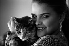 best buds (Paul Lundberg) Tags: nikonfe2 nikkor80200mmf45ais ilfordhp5400 kodakhc110 plustekopticfilm7300 film blackwhite 35mm portrait cat