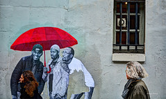 on the wall-2 (albyn.davis) Tags: paris wall umbrella red people streetart street window france europe travel color colorful bright vivid vibrant