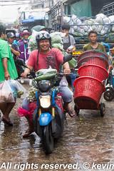 Bustling Khlong Toei market, Bangkok, Thailand (HellonEarth2006) Tags: bangkok bustling busy fruit khlongtoei market motorbike motorcycle porter rider shoppers smiling thailand vegetables wet