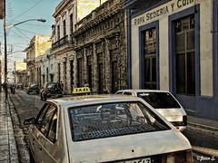 Taxi (Jean S..) Tags: cars taxi building store blue outdoor day white street sidewalk cuba yellow