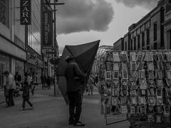 P1000831-1-2 Stormy outlook (Lawrence Holmes.) Tags: street uk blackandwhite umbrella lumix mono leeds streetphotography briggate 14mm gf1 candidandstreet