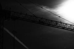 gru al chiaro di luna (Maieutica) Tags: sky bw moon milan night clouds stars nuvole milano luna bn wires cielo notte aereo fili astri gru stelle striscia clairdelune chiarodiluna airpale