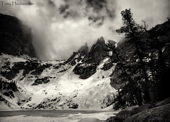 Emerald Lake - Explored (Tony Hochstetler) Tags: blackandwhite bw lake snow ice clouds nikon nik rmnp toned rockymountainnationalpark emeraldlake hallettpeak nikon1424mmf28 silverefexpro2 rememberthatmomentlevel1 flickrsfinestimages1 rememberthatmomentlevel2