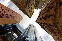 Look Up in Financial District Downtown Boston, Congress St and Quaker Ln (Greg DuBois Photography) Tags: lighting old light sky urban orange usa cloud white color detail building up boston skyline architecture clouds contrast canon buildings photography grey high warm downtown view unitedstates angle massachusetts rich gray wide perspective newengland overcast wideangle stormy historic lookingup lookup fisheye financialdistrict tall 8mm urbanskyline downtownboston samyang samyang8mm financialdistrictboston gregdubois gregduboisphotography