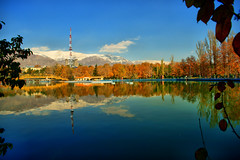 Mellat Park Lake and Snowy Alborz Mountains in Fall, Tehran, Iran (Persia) (eshare) Tags: park bridge autumn trees sky mountain lake mountains reflection tree fall water leaves clouds landscape persian leaf iran lakes bridges gimp persia hut iranian tehran  hdr highdynamicrange antenna iranians teheran  persians snowymountains tochal        mellatpark      urbanparks  alborzmountains hdrfromasingleraw     sal20f28 dynamicphotohdrsoftware  dphdr      sonyalpha20mmf28lens 2028     sonyalphadslra900 mellatparklake 900