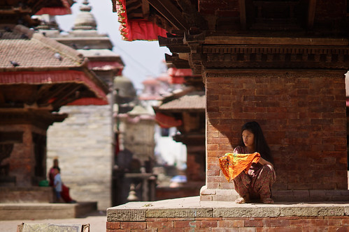 Little nepali girl under pagoda, Durbar Square, Katmandu, Nepal
