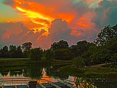Sun setting over Chicago Botanic Gardens (vdwarkadas) Tags: sunset chicago reflections il chicagobotanicgarden hdrsunset