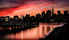 Sunset: New York City in Silhouette (Photography by Carlos Martin) Tags: longexposure autumn sunset newyork silhouette skyline architecture eastriver empirestatebuilding longislandcity finest flickrs gantryplazastatepark images1 sunsetmania goldenart ringexcellence dblringexcellence tplringexcellence flickrtravelaward eltringexcellence flickrsfinestimages1 flickrsfinestimages2 flickrsfinestimages3