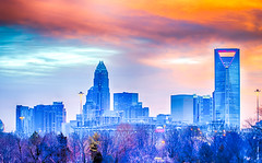 charlotte the queen city skyline at sunrise (DigiDreamGrafix.com) Tags: city morning travel blue trees winter red sky copyright usa sun cold alarm clock skyline architecture clouds buildings fire nc skyscrapers traffic charlotte thing transport first busy rush hour highrise chilly wakeup qc hdr copyrighted thequeencity atsunrise