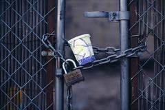 Tenfold (TerryJohnston) Tags: nyc newyorkcity newyork coffee brooklyn fence dof bokeh lock coffeecup chain redhook locked gasstationcoffee canoneos5dmarkiii 5dmarkiii