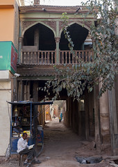 Old Town, Kashgar, Xinjiang Uyghur Autonomous Region, China (Eric Lafforgue Photography) Tags: china street wood travel people woman house man tree tourism girl sign vertical outside person reading book kid waiting day child hole outdoor balcony muslim chinese mother stall motorcycle uighur xinjiang silkroad kashgar daytime uyghur minority kashi anthropology cashier ethnicity sociology shopkeeper fourpeople peoplesrepublicofchina autonomy dayview turkic humanright uygur 4people ouigour littleshop img7910 colorpicture unrecognizablepeople coveredstreet crossedleg ethnicgroup coveredalley fourpersons chineseturkestan kachgar unrecognizableperson colourpicture xinjianguyghurautonomousregion qeqer easternandcentralasia turkicethnicgroup countycitylevel sculptedterrasse