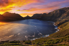 Chapman's Peak Overlooking Hout Bay, Cape Town, South Africa :: HDR (:: Artie | Photography :: Travel ~ Oct) Tags: africa sunset sea sky cliff cloud mountain nature water silhouette rock photoshop canon landscape southafrica bay coast outdoor dusk african tripod capetown cliffs cape serene mountainside peninsula ef hdr houtbay westerncape chapmanspeak capepeninsula cs3 atlanticcoast 1635mm mountainridge 3xp photomatix mountainpeak f28l tonemapping tonemap 5dmarkiii 5dm3