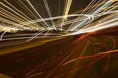 Westbound Traffic (Haseef Agha) Tags: lighting city light toronto ontario canada motion west cars car skyline night contrast speed america canon movement highway long exposure cityscape traffic artistic zoom north trails skylines canadian east fluid direction nighttime freeway commute 7d area directions commuting greater mississauga gta velocity westbound cityline on contrasting