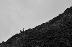 Hand in Hand (Jean S. Dupouy) Tags: blackandwhite clouds contrast work walking hiking together slovakia helping incline poprad hightatras slavkovsktt jeandupouy jeansilviudupouy
