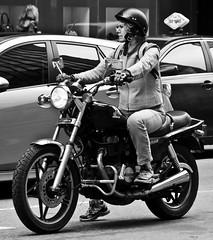 Keep the shiny side up! (Neil. Moralee) Tags: street woman white black monochrome up bike honda photography nikon shiny traffic mommy side helmet mother streetphotography neil motorbike motorcycle biker granny rider nighthawk nosocks hellsangels moralee d7000 neilmoraleenikon hellsgranny