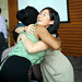 Tiffany Madison, left, hugs Angela Lou as the two members of Cohort 9 Secondary take a break during the Masters Project Presentations for the Urban Teacher Education Program (UTEP) at the Chicago Theological Seminary on the University of Chicago campus on