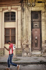 The old and the hip (Roy Cheung Photography) Tags: street new old architecture walking rust decay havana cuba young rusted historical caribbean hip cuban habana generation juxtapose rundown