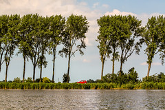 The Red Car near Zuiderwoude - Waterland, Holland (Dutchflavour) Tags: trees red lake holland tree water netherlands car nederland lagoon holanda nl noordholland waterland zuiderwoude